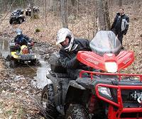Polaris Sportsman with fairing and windshiel in action